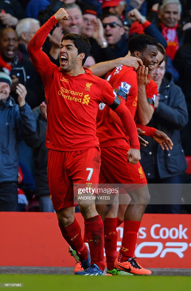 "Liverpool's Uruguayan striker Luis Suarez (L) celebrates scoring their late equalizer during the English Premier League football match between Liverpool and Chelsea at the Anfield stadium in Liverpool, northwest England, on April 21, 2013. The game finished 2-2. USE. No use with unauthorized audio, video, data, fixture lists, club/league logos or ""live"" services. Online in-match use limited to 45 images, no video emulation. No use in betting, games or single club/league/player publications."