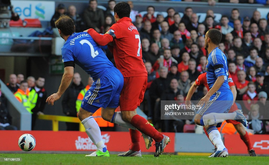 "Liverpool's Uruguayan striker Luis Suarez (2nd L) clashes with Chelsea's Serbian defender Branislav Ivanovic (L) in the build up to an incident where the Liverpool player appears to bite the Chelsea player during the English Premier League football match between Liverpool and Chelsea at the Anfield stadium in Liverpool, northwest England, on April 21, 2013. The game finished 2-2. AFP PHOTO / ANDREW YATES USE. No use with unauthorized audio, video, data, fixture lists, club/league logos or ""live"" services. Online in-match use limited to 45 images, no video emulation. No use in betting, games or single club/league/player publications."