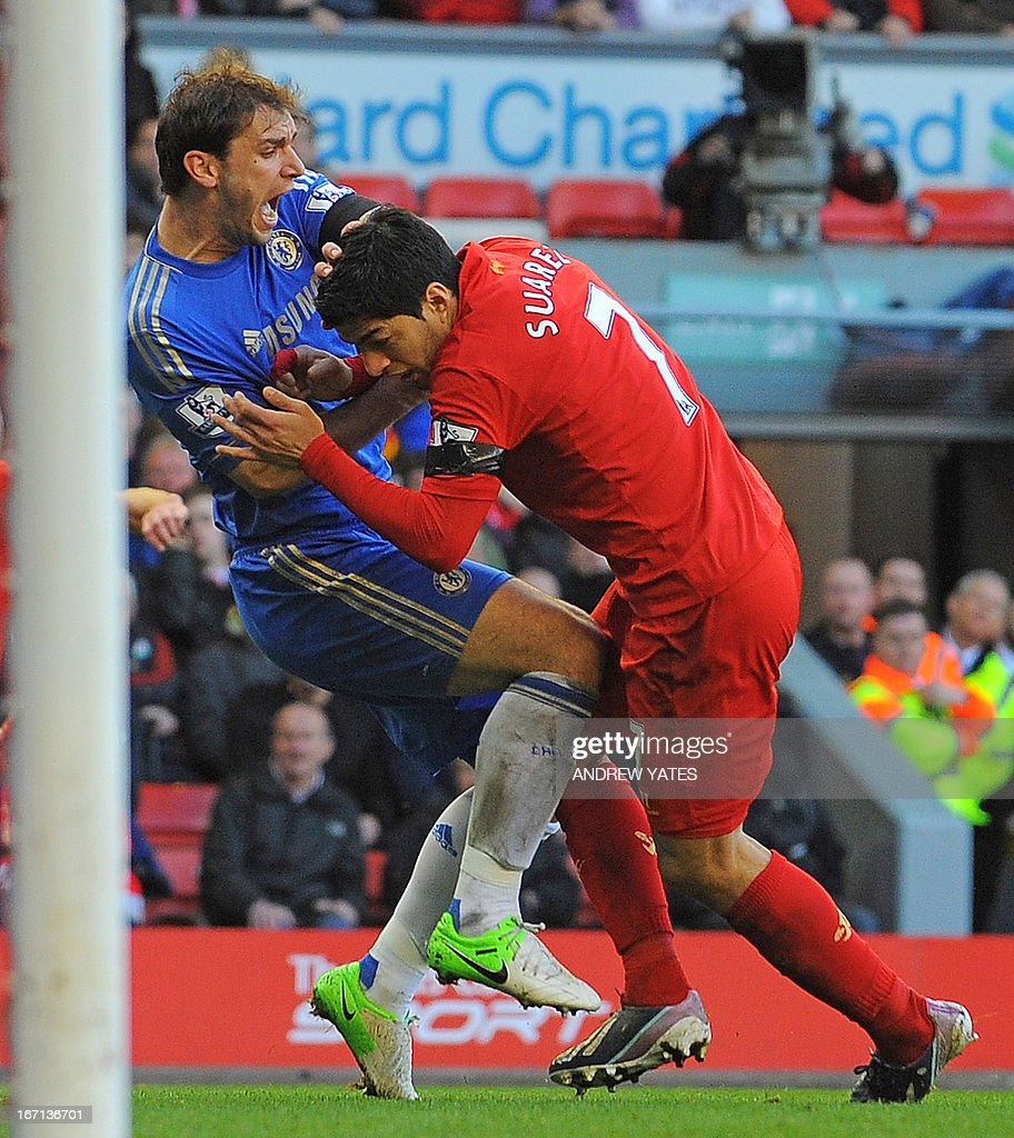 "Liverpool's Uruguayan striker Luis Suarez (R) clashes with Chelsea's Serbian defender Branislav Ivanovic (L) after appearing to bite the Chelsea player during the English Premier League football match between Liverpool and Chelsea at the Anfield stadium in Liverpool, northwest England, on April 21, 2013. USE. No use with unauthorized audio, video, data, fixture lists, club/league logos or ""live"" services. Online in-match use limited to 45 images, no video emulation. No use in betting, games or single club/league/player publications."