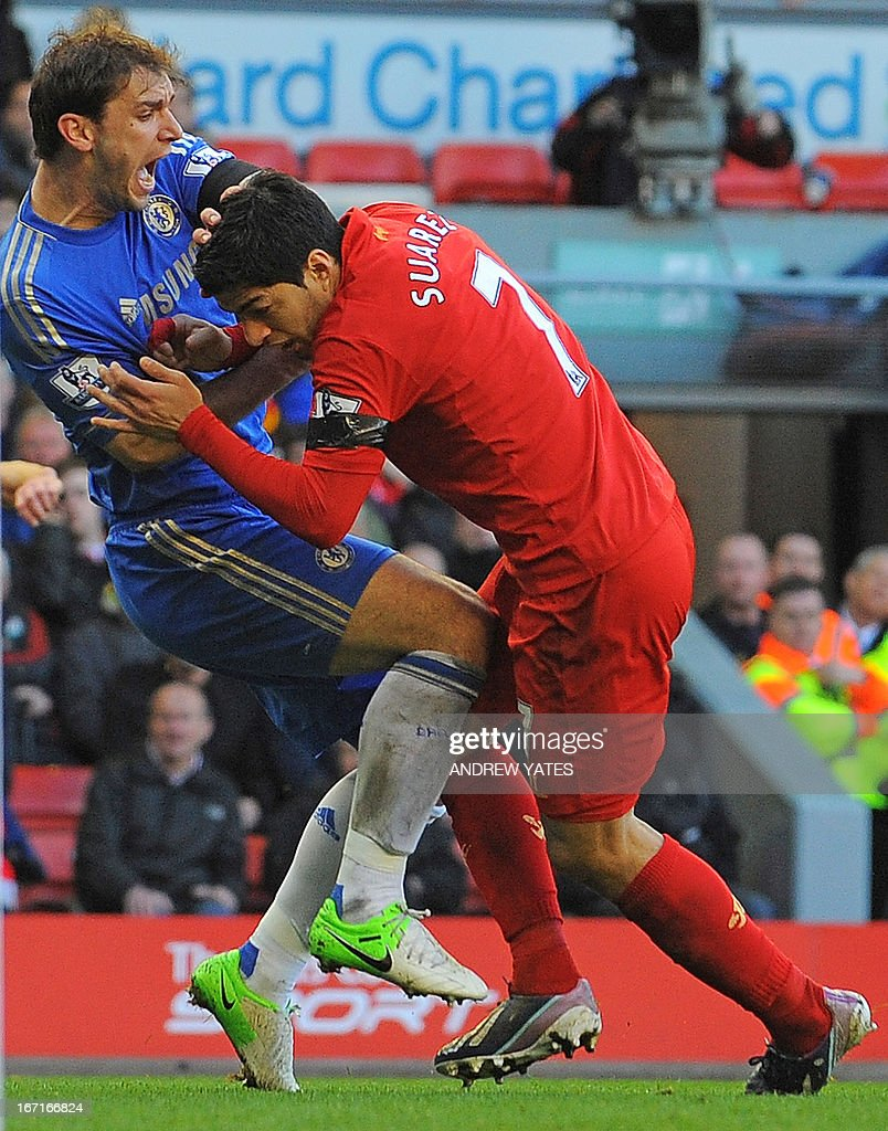 Liverpool's Uruguayan striker Luis Suarez clashes with Chelsea's Serbian defender Branislav Ivanovic after appearing to bite the Chelsea player...