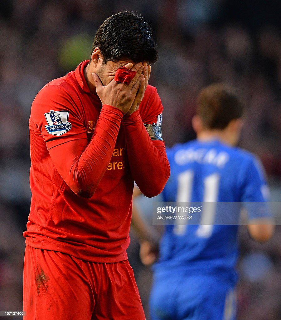 "Liverpool's Uruguayan striker Luis Suarez reacts during the English Premier League football match between Liverpool and Chelsea at the Anfield stadium in Liverpool, northwest England, on April 21, 2013. The game finished 2-2. USE. No use with unauthorized audio, video, data, fixture lists, club/league logos or ""live"" services. Online in-match use limited to 45 images, no video emulation. No use in betting, games or single club/league/player publications."