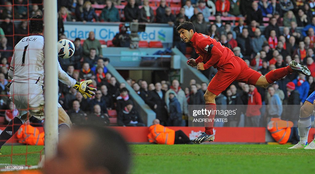 "Liverpool's Uruguayan striker Luis Suarez (R) scores their late equalizer past Chelsea's Czech goalkeeper Petr Cech (L) during the English Premier League football match between Liverpool and Chelsea at the Anfield stadium in Liverpool, northwest England, on April 21, 2013. The game finished 2-2. AFP PHOTO / ANDREW YATES USE. No use with unauthorized audio, video, data, fixture lists, club/league logos or ""live"" services. Online in-match use limited to 45 images, no video emulation. No use in betting, games or single club/league/player publications."