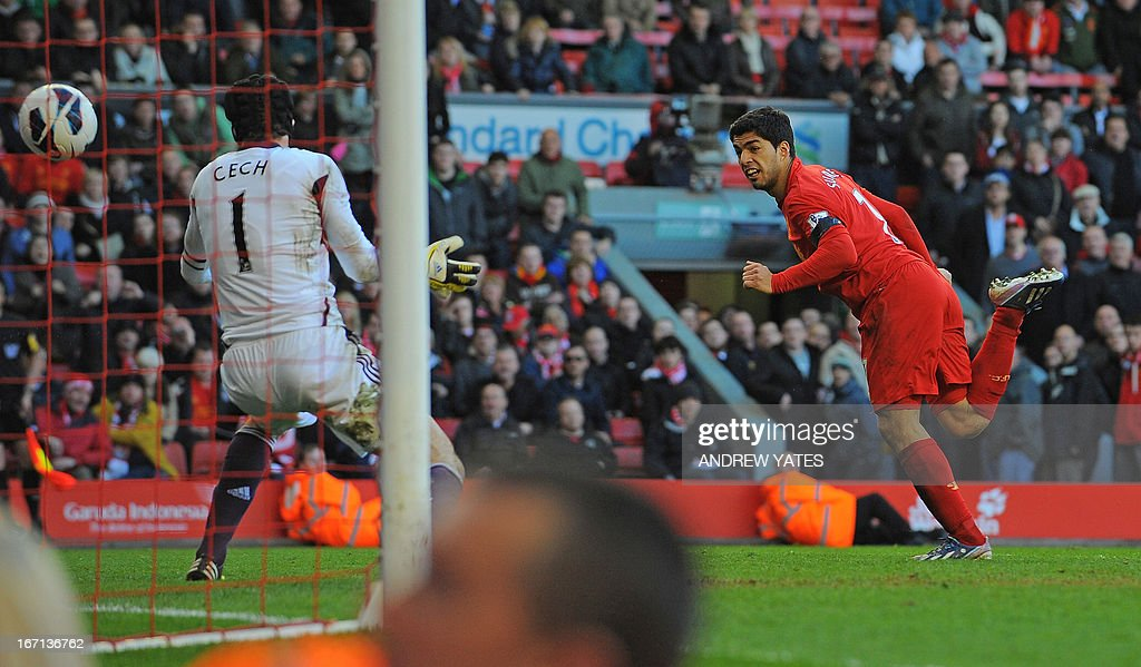 "Liverpool's Uruguayan striker Luis Suarez (R) scores their late equalizer past Chelsea's Czech goalkeeper Petr Cech (L) during the English Premier League football match between Liverpool and Chelsea at the Anfield stadium in Liverpool, northwest England, on April 21, 2013. The game finished 2-2. USE. No use with unauthorized audio, video, data, fixture lists, club/league logos or ""live"" services. Online in-match use limited to 45 images, no video emulation. No use in betting, games or single club/league/player publications."