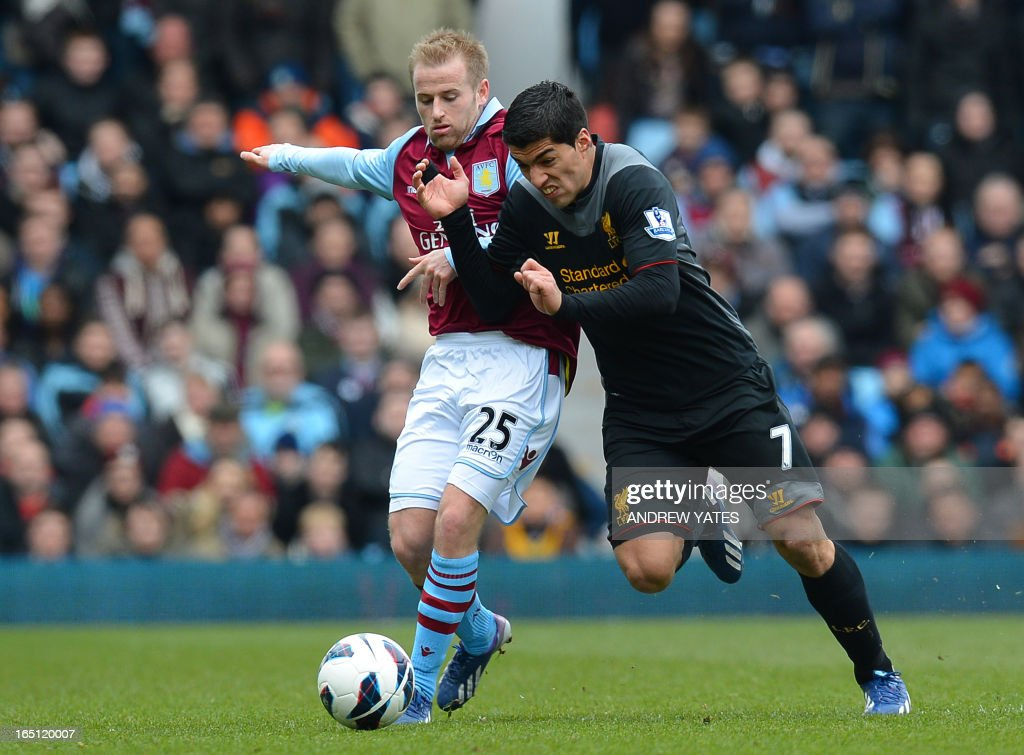 "Liverpool's Uruguayan striker Luis Suarez (R) vies with Aston Villa's Scottish midfielder Barry Bannan (L) during the English Premier League football match between Aston Villa and Liverpool at Villa Park in Birmingham, West Midlands, England on March 31, 2013. USE. No use with unauthorized audio, video, data, fixture lists, club/league logos or ""live"" services. Online in-match use limited to 45 images, no video emulation. No use in betting, games or single club/league/player publications."
