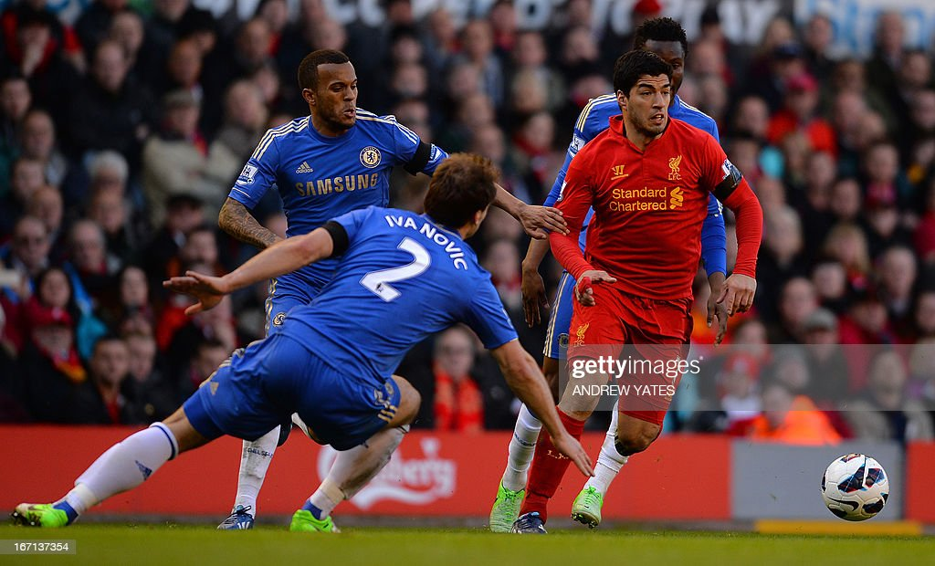 "Liverpool's Uruguayan striker Luis Suarez (R) vies with Chelsea's Serbian defender Branislav Ivanovic (2nd L) and Chelsea's English defender Ryan Bertrand (L) during the English Premier League football match between Liverpool and Chelsea at the Anfield stadium in Liverpool, northwest England, on April 21, 2013. The game finished 2-2. USE. No use with unauthorized audio, video, data, fixture lists, club/league logos or ""live"" services. Online in-match use limited to 45 images, no video emulation. No use in betting, games or single club/league/player publications."