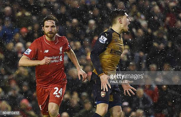 Liverpool's Welsh midfielder Joe Allen celebrates after scoring during the English Premier League football match between Liverpool and Arsenal at...