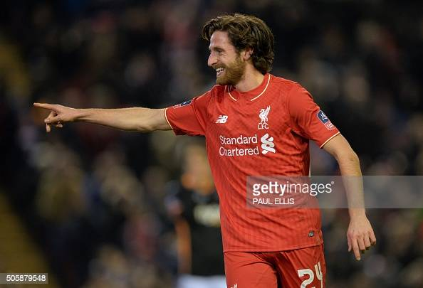 Liverpool's Welsh midfielder Joe Allen celebrates after scoring the opening goal of the English FA Cup third round replay football match between...