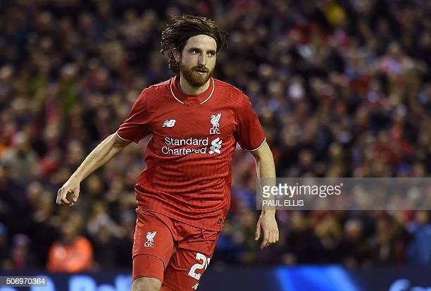 Liverpool's Welsh midfielder Joe Allen celebrates scoring the winning penalty in the shootout after the English League Cup semifinal second leg...