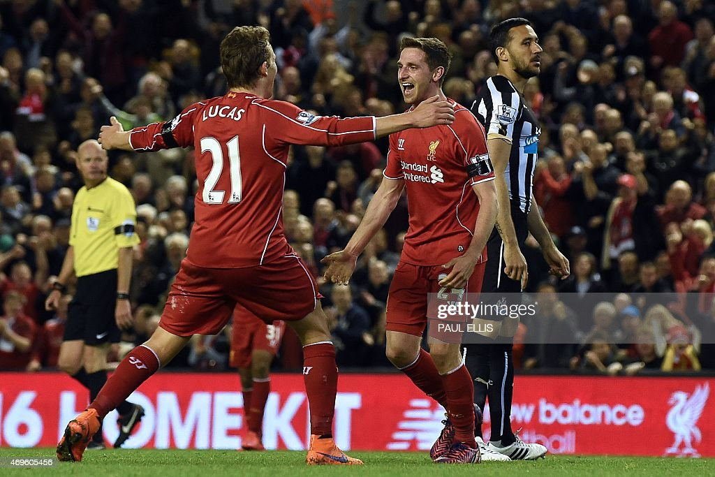 Liverpool's Welsh midfielder <a gi-track='captionPersonalityLinkClicked' href=/galleries/search?phrase=Joe+Allen+-+Jugador+de+f%C3%BAtbol+gal%C3%A9s&family=editorial&specificpeople=9629091 ng-click='$event.stopPropagation()'>Joe Allen</a> (2nd R) celebrates with Liverpool's English midfielder <a gi-track='captionPersonalityLinkClicked' href=/galleries/search?phrase=Jordan+Henderson&family=editorial&specificpeople=4940390 ng-click='$event.stopPropagation()'>Jordan Henderson</a> after scoring their second goal during the English Premier League football match between Liverpool and Newcastle United at Anfield in Liverpool, north west England on April 13, 2015. AFP PHOTO / PAUL ELLIS