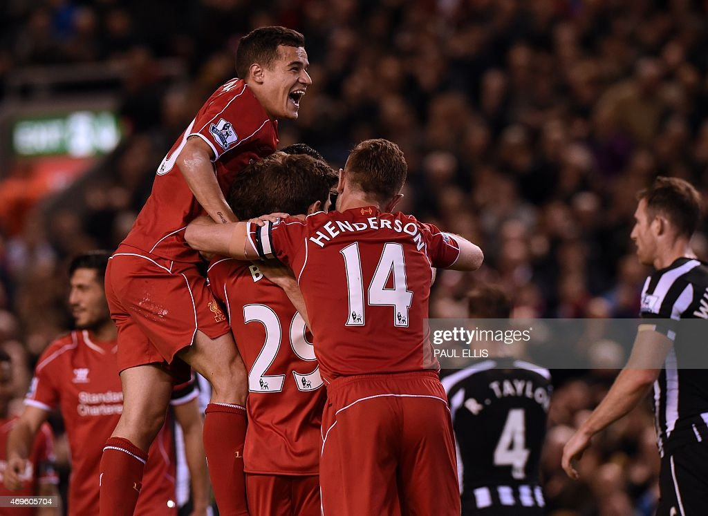 Liverpool's Welsh midfielder <a gi-track='captionPersonalityLinkClicked' href=/galleries/search?phrase=Joe+Allen+-+Jugador+de+f%C3%BAtbol+gal%C3%A9s&family=editorial&specificpeople=9629091 ng-click='$event.stopPropagation()'>Joe Allen</a> celebrates with teammates after scoring their second goal during the English Premier League football match between Liverpool and Newcastle United at Anfield in Liverpool, north west England on April 13, 2015. AFP PHOTO / PAUL ELLIS