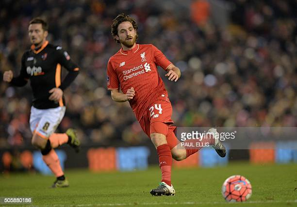 Liverpool's Welsh midfielder Joe Allen passes the ball during the English FA Cup third round replay football match between Liverpool and Exeter City...