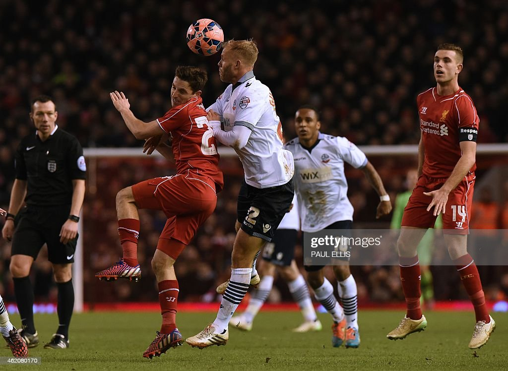 Liverpool's Welsh midfielder <a gi-track='captionPersonalityLinkClicked' href=/galleries/search?phrase=Joe+Allen+-+Welsh+Soccer+Player&family=editorial&specificpeople=9629091 ng-click='$event.stopPropagation()'>Joe Allen</a> (2nd L) vies with Bolton Wanderers' Icelandic striker <a gi-track='captionPersonalityLinkClicked' href=/galleries/search?phrase=Eidur+Gudjohnsen&family=editorial&specificpeople=171363 ng-click='$event.stopPropagation()'>Eidur Gudjohnsen</a> during the FA Cup fourth round football match between Liverpool and Bolton Wanderers at Anfield in Liverpool, northwest England, on January 24, 2015. AFP PHOTO / PAUL ELLIS USE. No use with unauthorized audio, video, data, fixture lists, club/league logos or live services. Online in-match use limited to 45 images, no video emulation. No use in betting, games or single club/league/player publications. ==