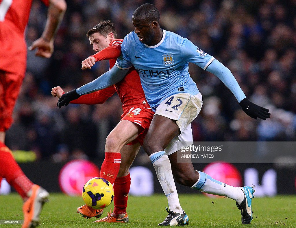Liverpool's Welsh midfielder Joe Allen (L) vies with Manchester City's Ivorian defender Yaya Touré during the English Premier League football match between Manchester City and Liverpool at Etihad Stadium in Manchester, northwest England on December 26, 2013. Manchester City won 2-1. AFP PHOTO / ANDREW YATES USE. No use with unauthorized audio, video, data, fixture lists, club/league logos or live services. Online in-match use limited to 45 images, no video emulation. No use in betting, games or single club/league/player publications.