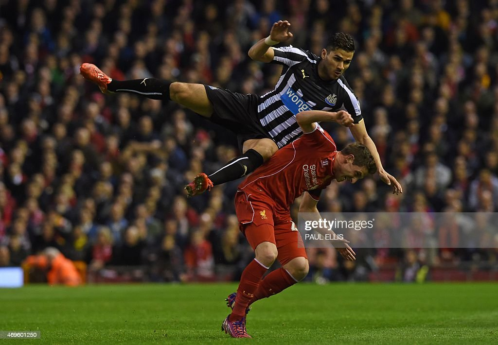 Liverpool's Welsh midfielder <a gi-track='captionPersonalityLinkClicked' href=/galleries/search?phrase=Joe+Allen+-+Jugador+de+f%C3%BAtbol+gal%C3%A9s&family=editorial&specificpeople=9629091 ng-click='$event.stopPropagation()'>Joe Allen</a> vies with Newcastle United's French midfielder Mehdi Abeid (L) during the English Premier League football match between Liverpool and Newcastle United at Anfield in Liverpool, north west England on April 13, 2015. AFP PHOTO / PAUL ELLIS