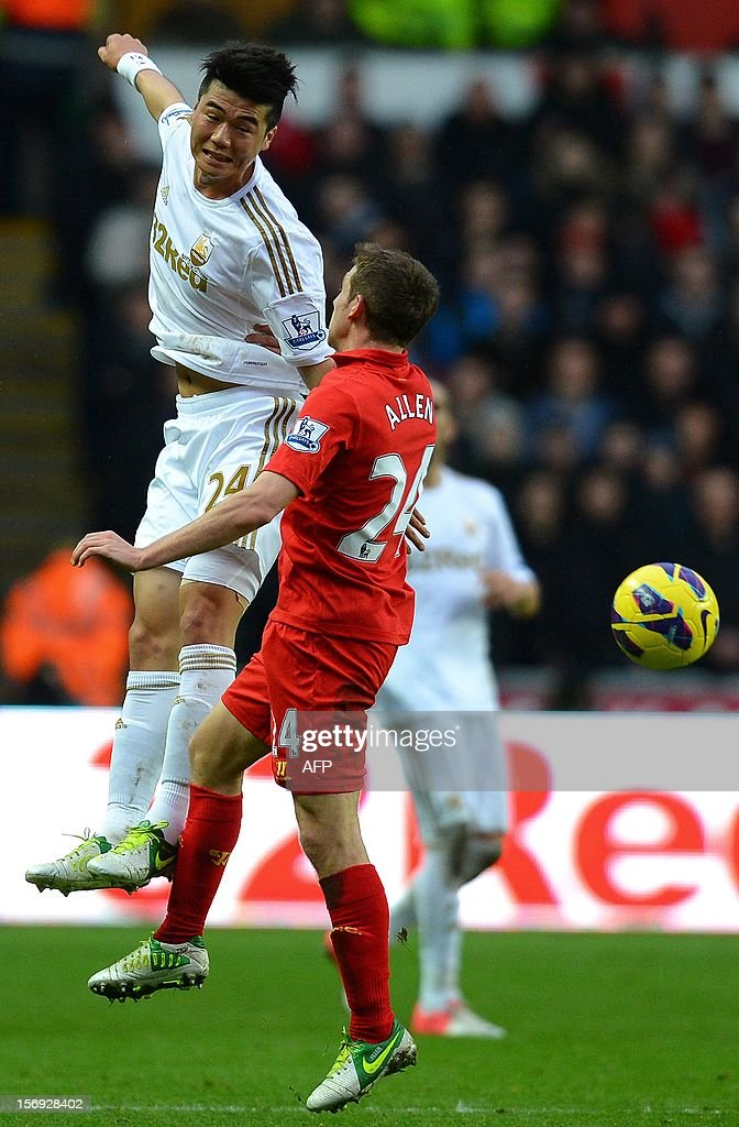"""Liverpool's Welsh midfielder Joe Allen (R) vies with Swansea City's South Korean midfielder Ki Sung-Yueng during the English Premier League football match between Swansea City and Liverpool at The Liberty stadium in Swansea, south Wales on November 25, 2012. The match ended in a goal-less draw. AFP PHOTO/ANDREW YATES. RESTRICTED TO EDITORIAL USE. No use with unauthorized audio, video, data, fixture lists, club/league logos or """"live"""" services. Online in-match use limited to 45 images, no video emulation. No use in betting, games or single club/league/player publications."""