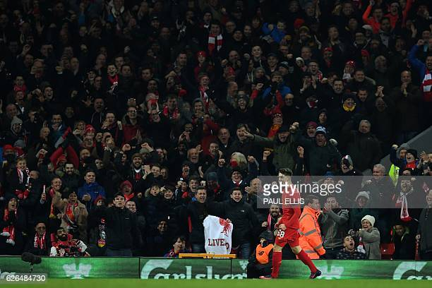 Liverpool's Welsh striker Ben Woodburn celebrates scoring his team's second goal during the EFL Cup quarterfinal football match between Liverpool and...