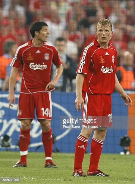 Liverpool's Xabi Alonso and Dirk Kuyt stand dejected
