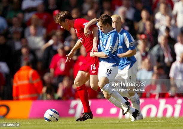 Liverpool's Xabi Alonso is challenged by Birmingham City's Neil Kilkenny