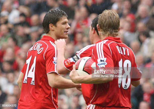 Liverpool's Xabi Alonso is congratulated by his team mates Robbie Fowler and Dirk Kuyt after scoring the equaliser