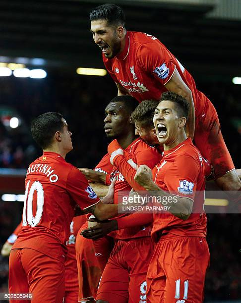 Liverpool's Zaireborn Belgian striker Christian Benteke celebrates with teammates after scoring the opening goal of during the English Premier League...