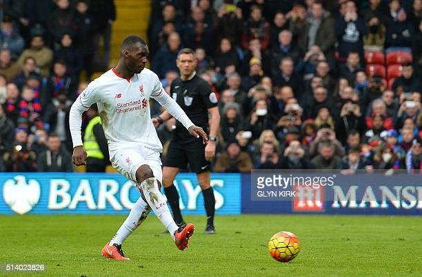 Liverpool's Zaireborn Belgian striker Christian Benteke scores their late winnning goal from the penalty spot during the English Premier League...