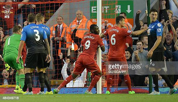 Liverpool's Zaireborn Belgian striker Christian Benteke wheels away in celebration after scoring his team's first goal during the English Premier...