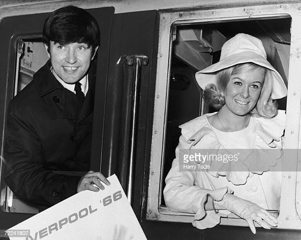 Liverpudlian comedian Jimmy Tarbuck poses with Maureen Martin 'Miss Liverpool' at London's Euston Station 28th February 1966 Together with other...
