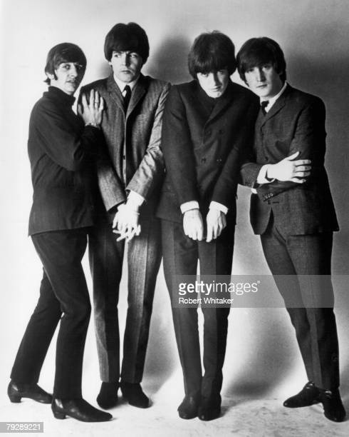 Liverpudlian pop group The Beatles wearing suits for a studio phot shoot circa 1965 From left to right Ringo Starr Paul McCartney George Harrison and...