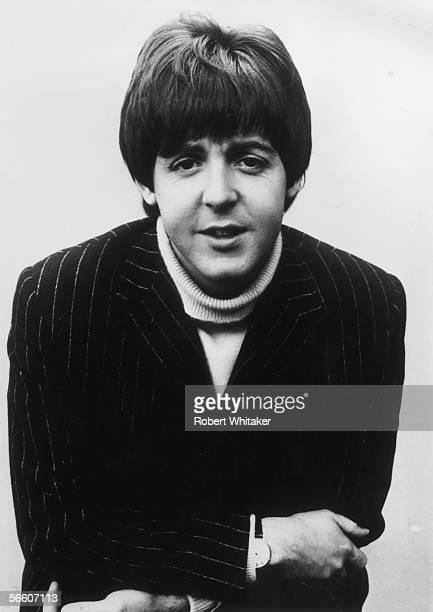 Liverpudliuan pop star Paul McCartney of The Beatles during a break in the shooting of The Beatles' new film 'Help' 21st June 1965 He is wearing a...