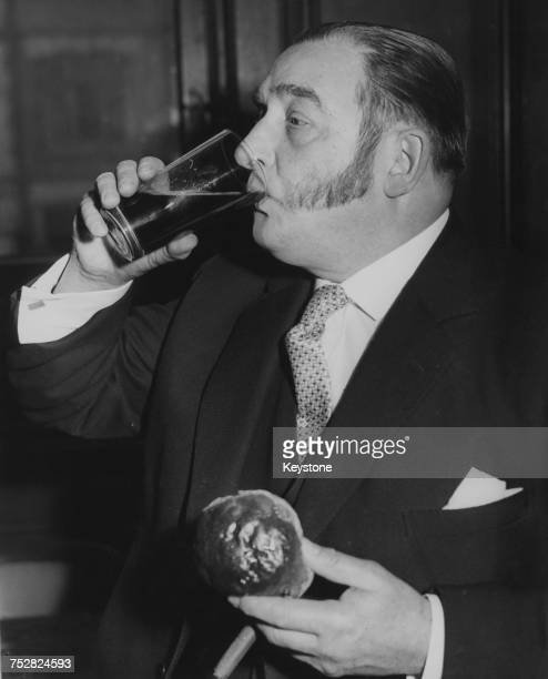 Liveryman Arthur Peters of the Stationers' Company enjoys the annual Cakes And Ale Ceremony at Stationers' Hall in the City of London 2nd March 1960...