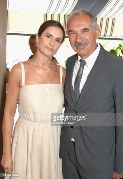 Livia Firth and Carlo Capasa attend an intimate lunch hosted by Livia Firth Carlo Capasa and Caroline Scheufele to announce Chopard as partner for...