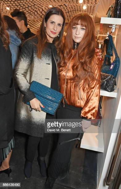 Livia Firth and Nicola Roberts attend the opening of the BOTTLETOP flagship store on Regent Street on December 5 2017 in London England