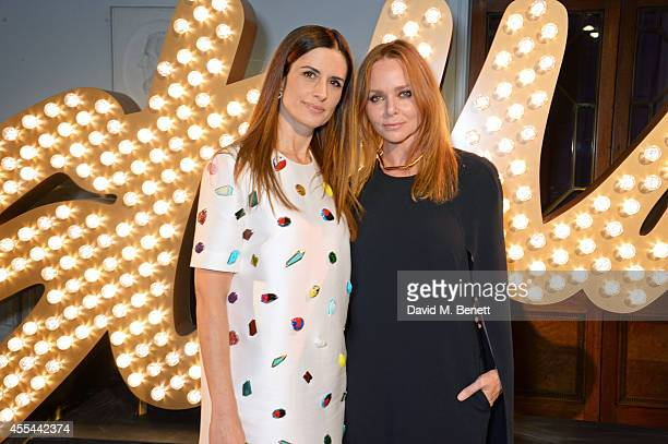 Livia Firth and Stella McCartney attend The London 2014 Stella McCartney Green Carpet Collection during London Fashion Week at The Royal British...