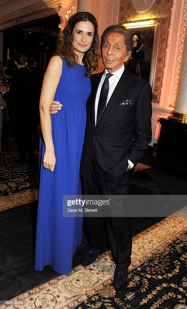 Livia Firth (L) and Valentino Garavani attend a drinks reception at the British Fashion Awards 2012 at The Savoy Hotel on November 27, 2012 in London, England.