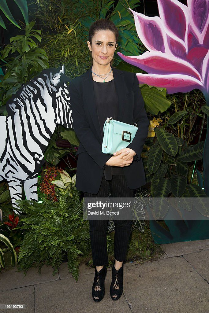 Livia Firth arrives at Roger Vivier Summer Party at Loulou's on May 22 2014 in London England