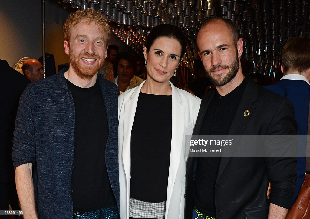 Livia Firth (C) poses with Bottletop founders Oliver Wayman (L) and Cameron Saul at the Bottletop Regent Street store launch on May 24, 2016 in London, England.