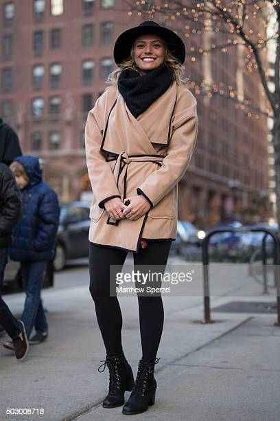 Livia Kleinow is seen on Michigan Avenue wearing black Forever 21 hat and scarf light tan Vince coat and black Steve Madden shoes on December 19 2015...