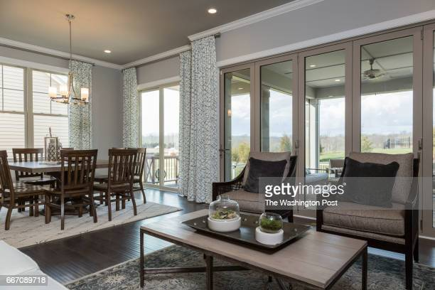 Living area that opens to Screened in Porch in the Tradition Model at Regency at Creekside on March 28 2017 in Gainesville Virginia