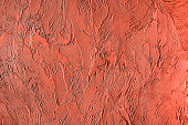 Trendy living coral colored textured background for concept or product