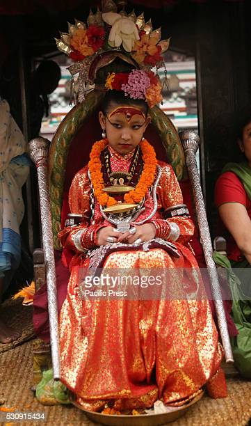Living Goddess Kumari observes the chariot procession during the first day of Rato Machhendranath festival Rato Machhendranath is worshipped both by...