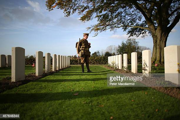 Living history enthusiast Chris Barker wears World War One period military uniform as he visits the Commonwealth War Graves Commission YFarm Cemetery...