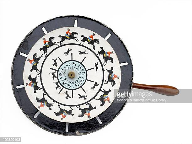 Living pictures optical illusion' optical toy c1860 Set with eight coloured Phenakistiscope discs and wheel with handle optical toy with box labelled...