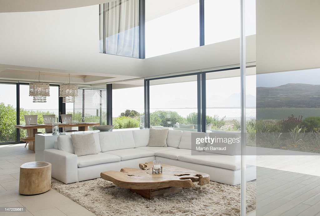 Living room and dining room of modern house : Stock Photo