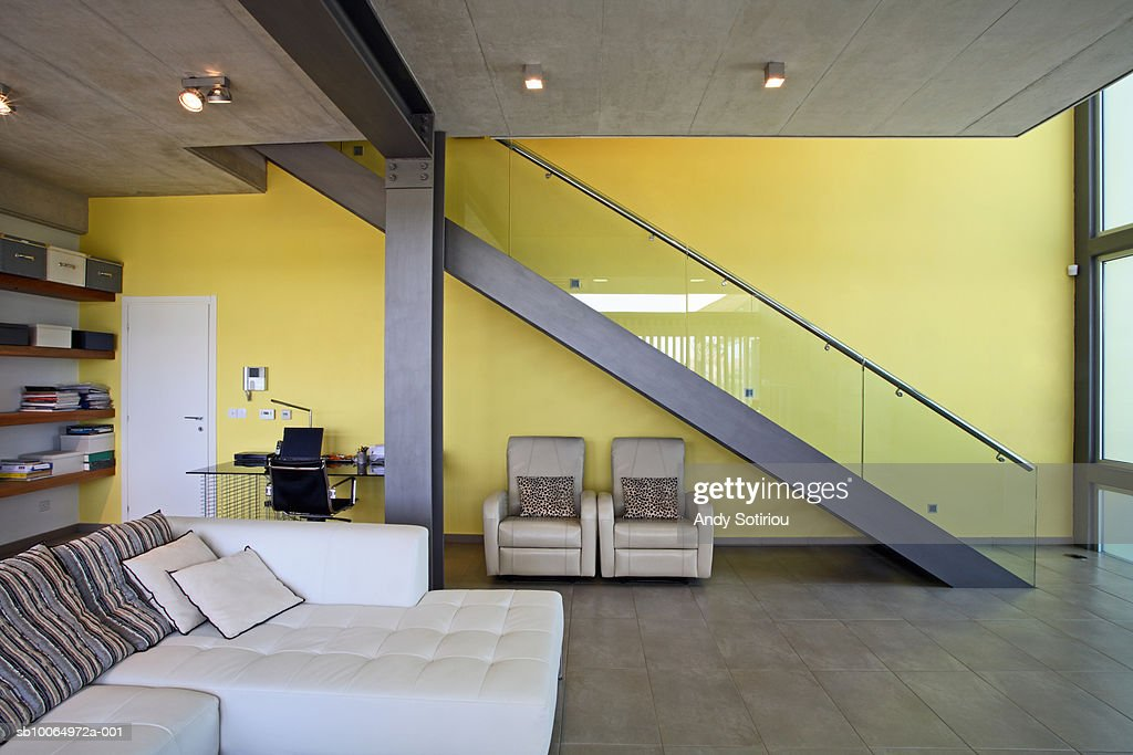 Living room and staircase in contemporary house : Stock Photo