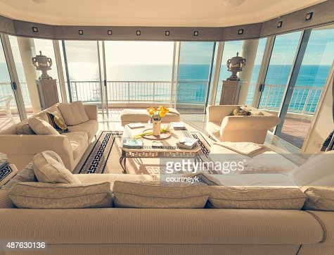 Living room in a luxury beachfront apartment with view