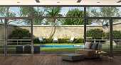 Living room of a villa overlooking the garden with small pool - 3d rendering