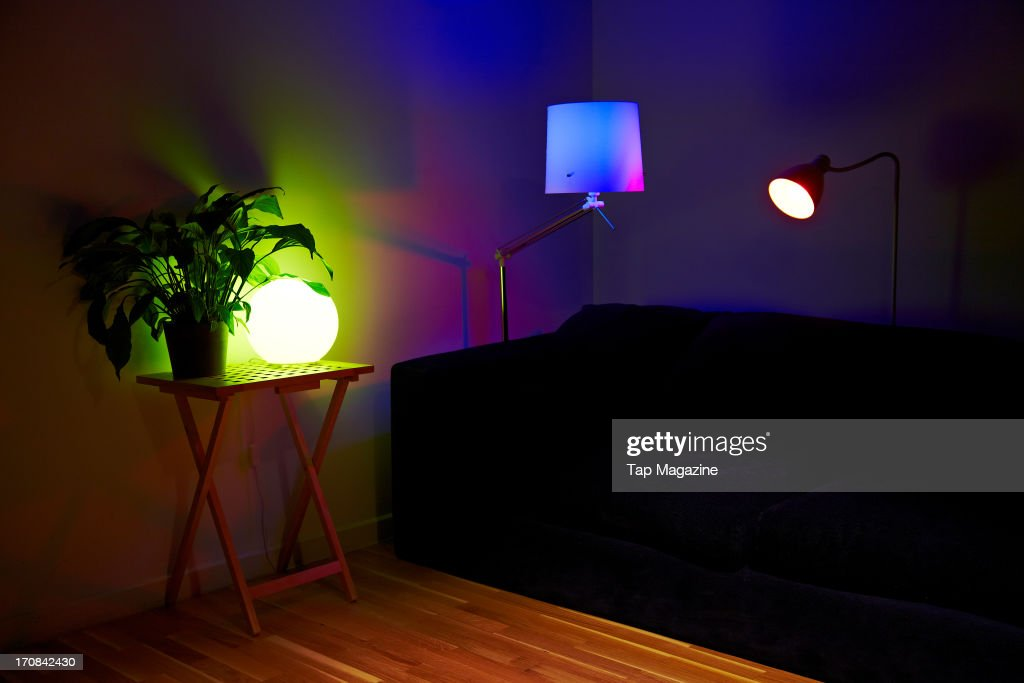 A living room setup with lamps using Philips Hue iPhone-controlled lightbulbs photographed during a studio shoot for Tap Magazine, November 29, 2012.