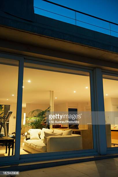Living room viewed through window at night