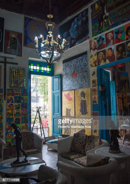 Living room walls lamp and window at the Ileana Sanchez and Joel Jover house The Cuban artists collect old objects and their house is a tourist...