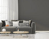 3D illustration. Modern interior of the living room with a gray sofa